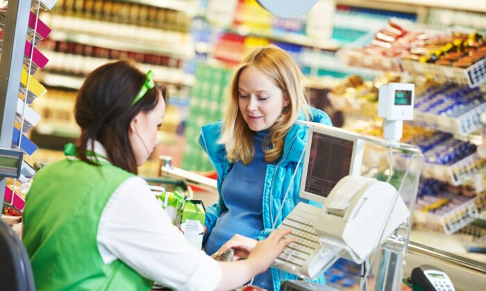 Cashiers could see a dangerous rise in BPA levels in their bloodstream if they handle receipts after using skincare products, including hand sanitizer. (Dmitry Kalinovsky/Shutterstock)