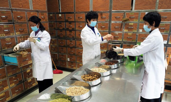 Medical workers prepare traditional Chinese medicine (TCM) at a TCM hospital as the country is hit by an outbreak of the new coronavirus, in Binzhou, Shandong Province, China, on Feb. 5, 2020. (cnsphoto via Reuters)