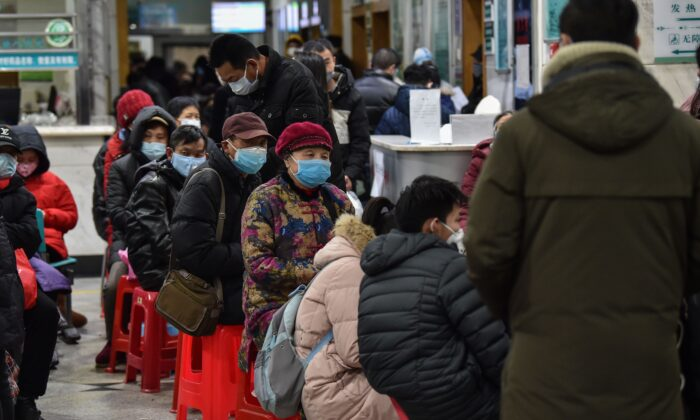 People wearing facemasks as they wait at the Wuhan Red Cross Hospital in Wuhan on Jan. 24, 2020. (Hector Retamal/AFP via Getty Images)