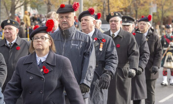 Veterans march during Remembrance Day ceremonies in Montreal on Nov. 11, 2019. Veterans ombudsman Craig Dalton is calling for nationwide consultations to develop what he says is a much-needed vision and plan for supporting former service members and their families.  (The Canadian Press/Ryan Remiorz)