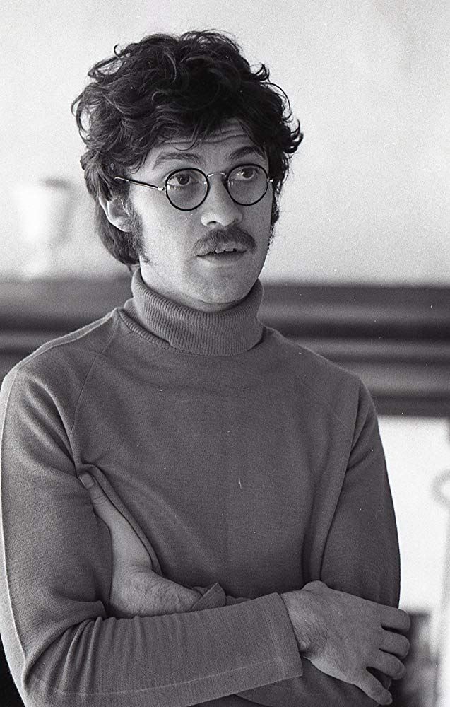 man with turtleneck and glasses