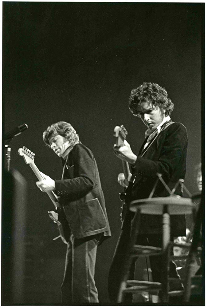 two guitarists on stage
