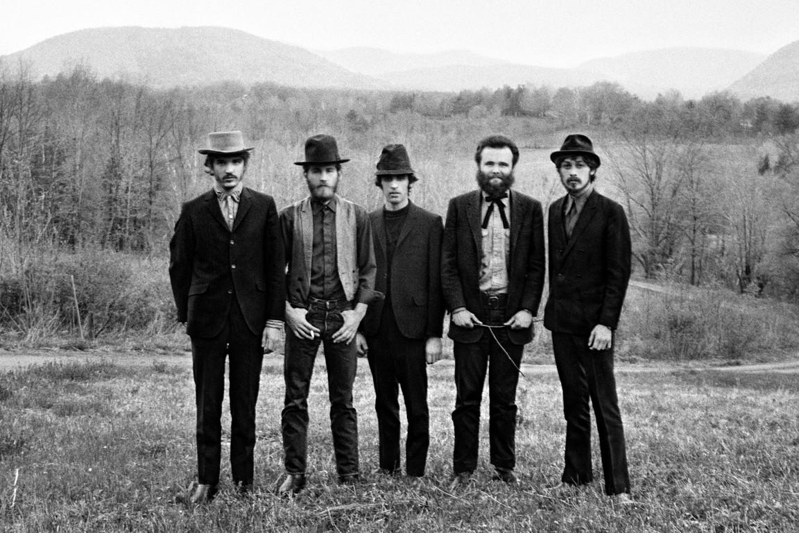 5 men standing in a field