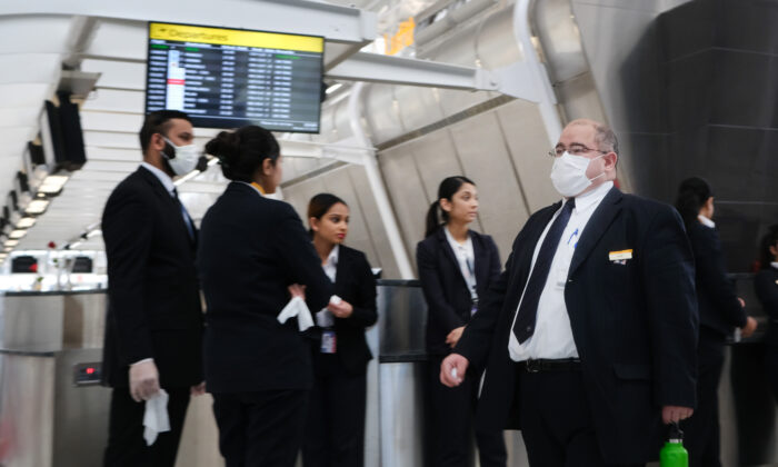At the terminal that serves planes bound for China, airport employees wear medical masks at John F. Kennedy Airport (JFK) out of concern over the Novel Coronavirus in New York City on Jan. 31, 2020. (Spencer Platt/Getty Images)