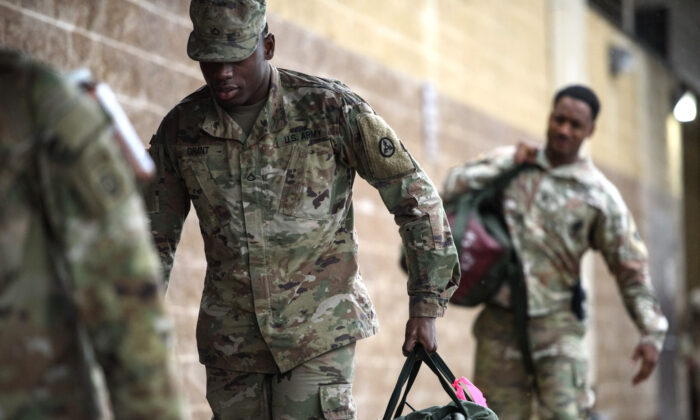 U.S. troops from the Army's 82nd Airborne Division arrive at Green Ramp for a deployment to the Middle East in Fort Bragg, North Carolina, on Jan. 4, 2020. (Andrew Craft/Getty Images)