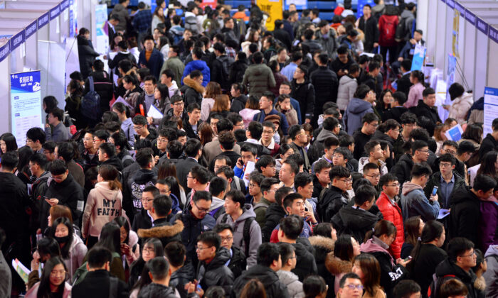 Students are seen at a job fair for graduates at a university in Shenyang, Liaoning Province, China on March 21, 2019. (Reuters)