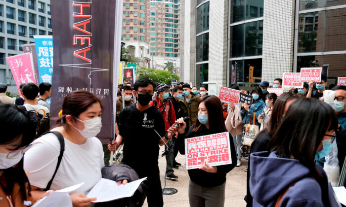 Winnie Yu, chairwoman of the Hospital Authority Employees Alliance (HAEA), speaks during a strike outside the Hospital Authority as they demand for Hong Kong to close its border with China to reduce the coronavirus spreading, in Hong Kong, China on Feb. 4, 2020. (Tyrone Siu/Reuters)