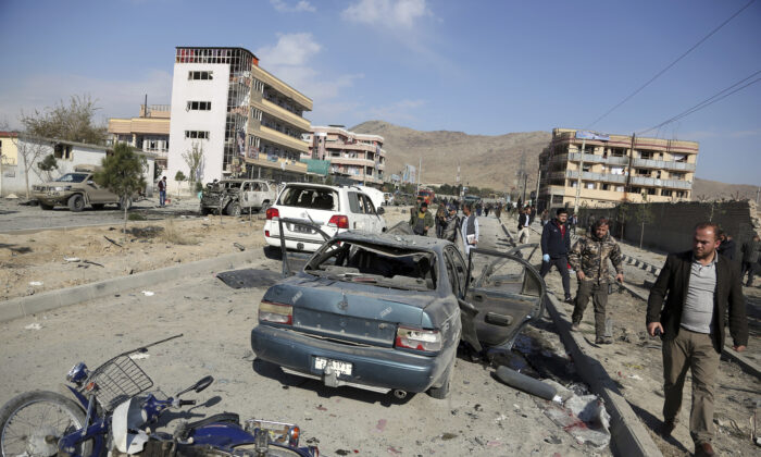 Afghan security personnel gather at the site of a car bomb attack in Kabul, Afghanistan in a Nov. 13, 2019, file photograph. (Rahmat Gul/AP Photo)