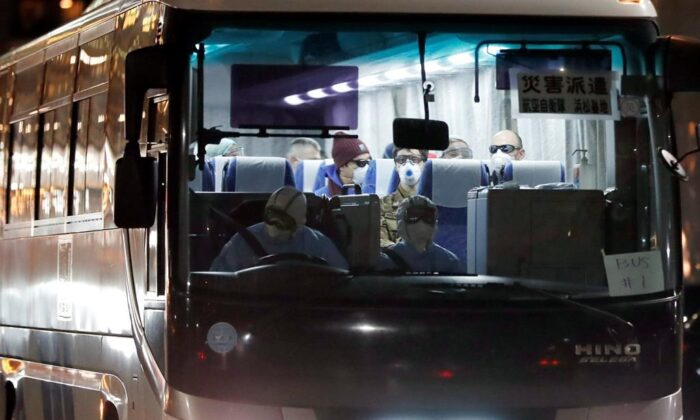 A bus carrying the passengers from the quarantined Diamond Princess cruise ship leaves a port in Yokohama, near Tokyo, on Feb. 21, 2020. (Eugene Hoshiko/AP Photo)