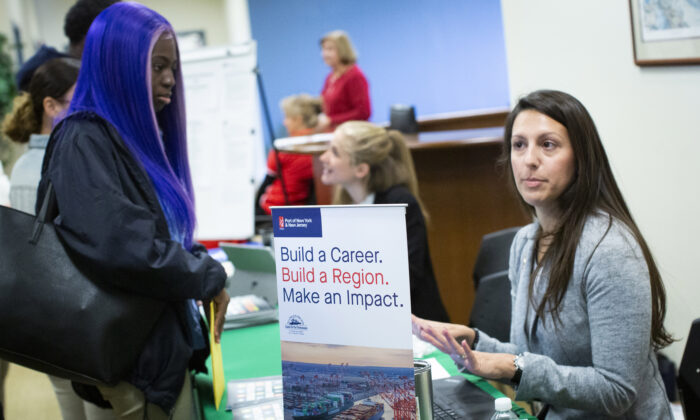 A woman offers information to attendees during a Port Authority of New York and New Jersey job fair at the Union County College in Elizabeth, N.J., on Nov. 8, 2019. (Kena Betancur/Getty Images)