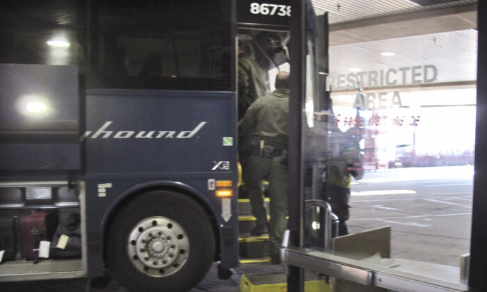 Agents for Customs and Border Protection board a Greyhound bus headed for Portland, Ore., at the Spokane Intermodal Center, a terminal for buses and Amtrak, in Spokane, Wash., on Feb.13, 2020. (Nicholas K. Geranios/AP/File)