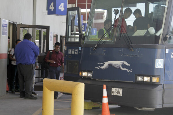 An asylum seeker from Guatemala boards a Greyhound bus in El Paso,