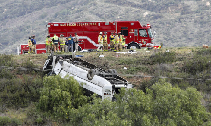 A bus rolled down an embankment off Interstate 15 in North San Diego County on Feb. 22, 2020, killing several people and injuring others. (Don Boomer/The San Diego Union-Tribune via AP)