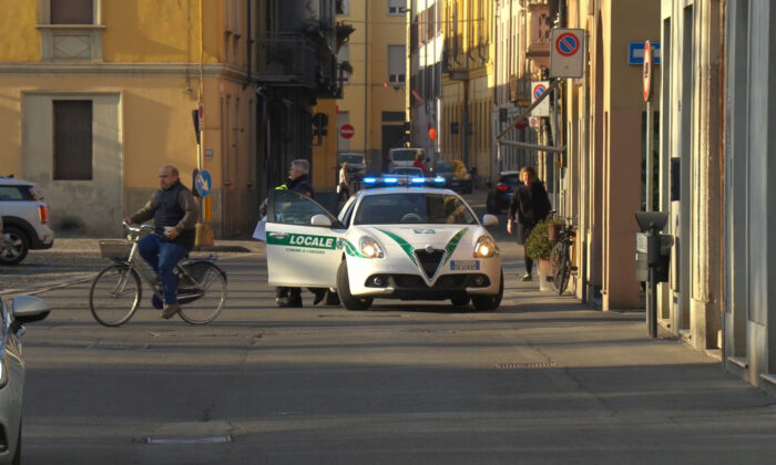 A police car is seen in the village of Codogno after officials told residents to stay home and suspend public activities as 14 cases of coronavirus are confirmed in northern Italy, in this still image taken from video in the province of Lodi, Italy, on Feb. 21, 2020. (Reuters TV)