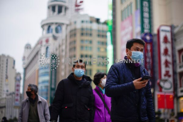 People wear masks at a main shopping area, in downtown Shanghai