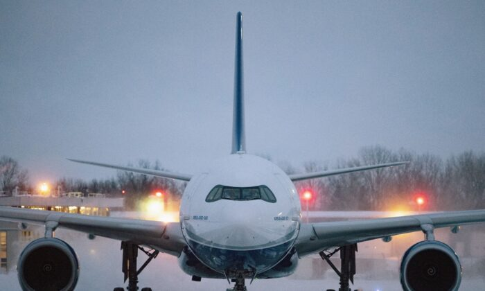 A plane carrying 176 Canadian citizens from the centre of the global novel coronavirus outbreak in Wuhan, China, arrives at CFB Trenton, in Trenton, Ont., on Friday, Feb. 7, 2020. The Canadian Press/Justin Tang