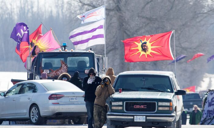 Protesters at a rail blockade in Tyendinaga, near Belleville, Ont., on Feb. 22, 2020, in support of the Wet'suwet'en who oppose work on a pipeline in northern B.C. (The Canadian Press/Lars Hagberg)