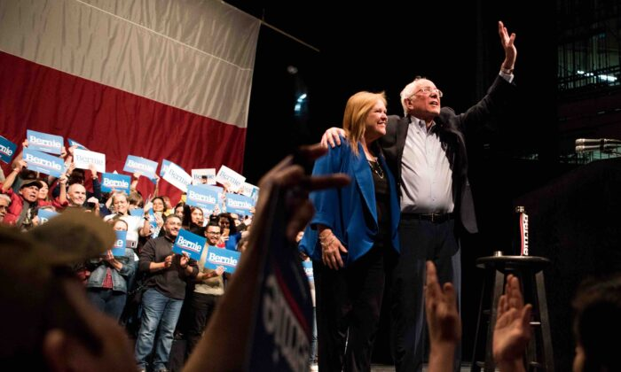 Democratic presidential candidate Sen. Bernie Sanders (I-VT) waves to the crowd alongside his wife, Mary Jane O'Meara Sanders, at a campaign rally in El Paso, Texas, on Feb. 22, 2020. (Cengiz Yar/Getty Images)