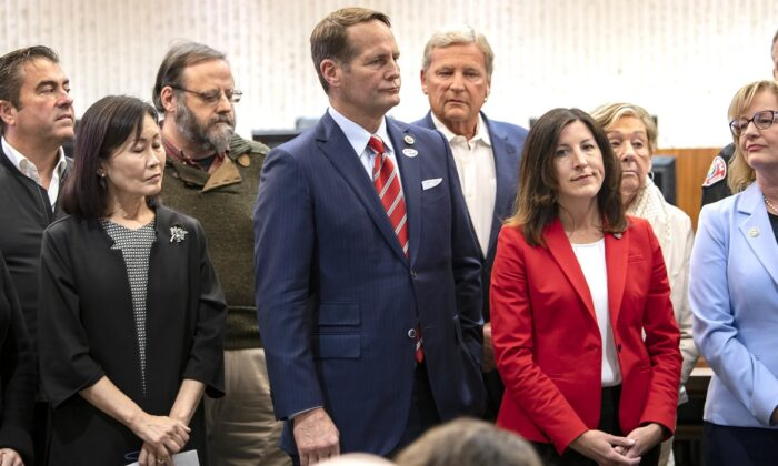 A group of officials including member of the Orange County Board of Supervisors Michele Park Steele, from third left, Rep. Harley Rouda, Assemblywoman Cottie Petrie-Norris and Costa Mesa Mayor Katrina Foley, hold a news conference in Costa Mesa, Calif., on Feb. 22, 2020. (Mindy Schauer/The Orange County Register via AP)