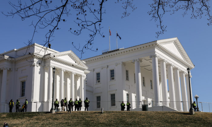 Virginia State Police stand guard after gun rights advocates took part in a rally at the Virginia State Capitol in Richmond, Va., on Jan. 20, 2020. (Samira Bouaou/The Epoch Times)