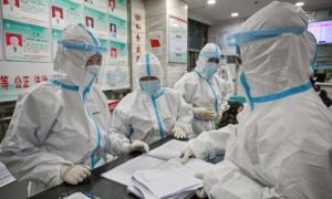 Exclusive: Government Staff Who Deal With Outbreak in China's Coronavirus Epicenter Are Getting Infected