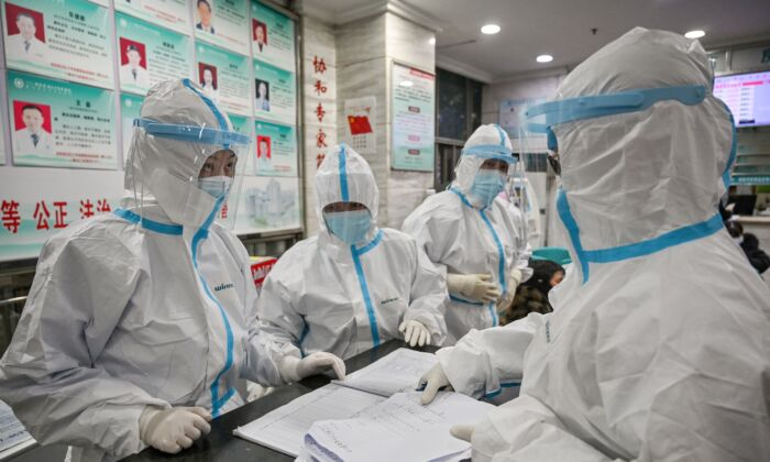 Medical staff members work at the Wuhan Red Cross Hospital in Wuhan, China, on Jan. 25, 2020. (HECTOR RETAMAL/AFP via Getty Images)