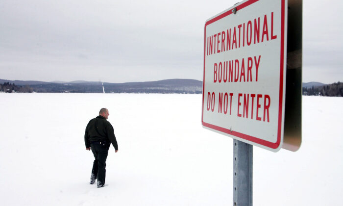 U.S. Border Patrol Agent Andrew Mayer walks onto a frozen lake during a patrol on the lake that is split between Canadian territory to the right and the U.S., near Norton, Vermont, on March 22, 2006.  Joe Raedle/Getty Images