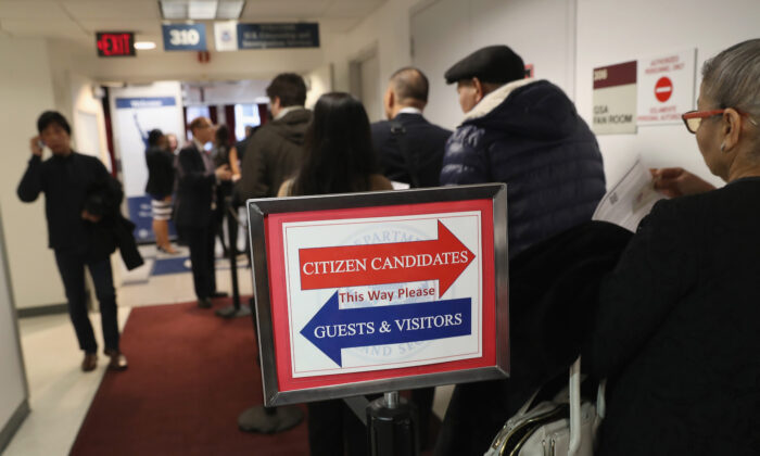 Immigrants wait in line to become U.S. citizens at a naturalization ceremony in New York City on Feb. 2, 2018. (John Moore/Getty Images)
