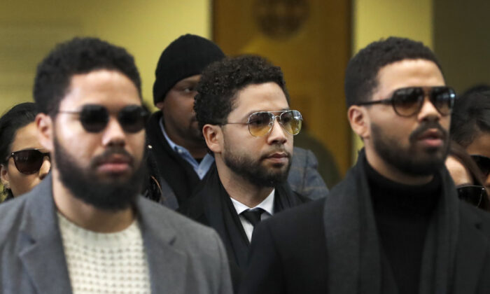 Actor Jussie Smollett, center, departs after an initial court appearance at the Leighton Criminal Courthouse, in Chicago, on Feb. 24, 2020. (Charles Rex Arbogast/AP Photo)