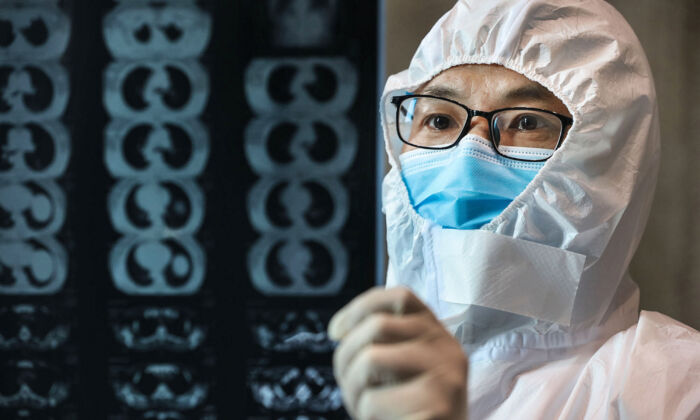 A doctor looks at a lung CT image at a hospital in Yunmeng county, Xiaogan city, in China's central Hubei province, on Feb. 20, 2020. (STR/AFP via Getty Images)