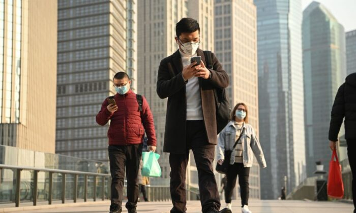 People wearing protective face masks on an overpass in Shanghai on Feb. 24, 2020. (Noel Celis/AFP via Getty Images)