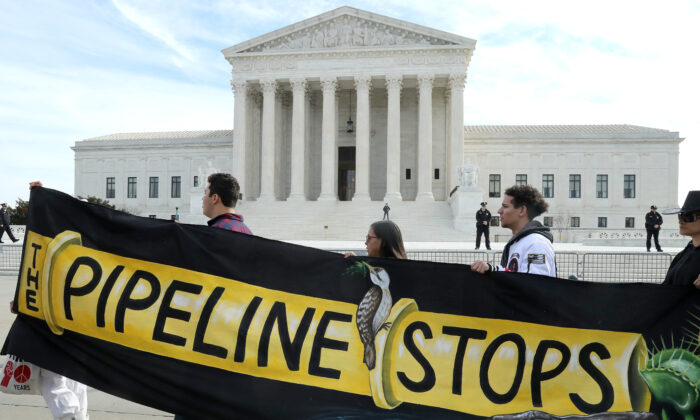Climate activist groups protest in front of the U.S. Supreme Court as oral arguments are heard in U.S. Forest Service and Atlantic Coast Pipeline, LLC v. Cowpasture River Assn., in Washington on Feb. 24, 2020. (Mark Wilson/Getty Images)