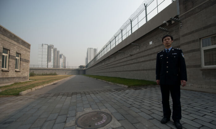 A prison guard stands in a courtyard inside the No.1 Detention Center in Beijing on Oct. 25, 2012. (Ed Jones/AFP via Getty Images)
