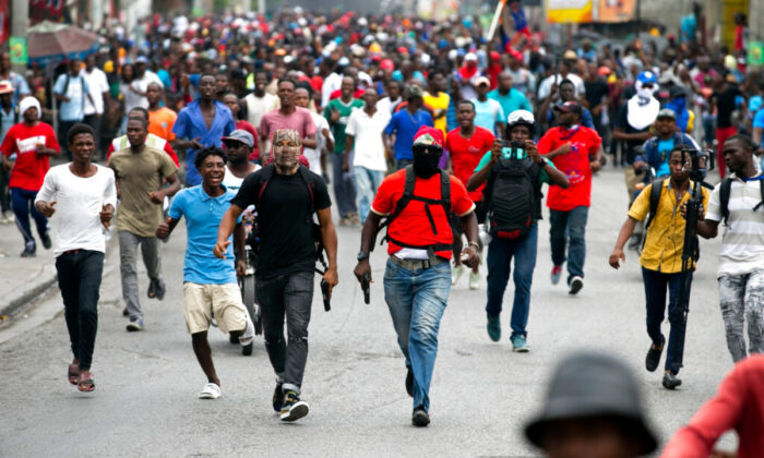Armed off-duty police officers protest over police pay and working conditions, in Port-au-Prince, Haiti, on Feb. 23, 2020. (Dieu Nalio Chery/AP Photo)