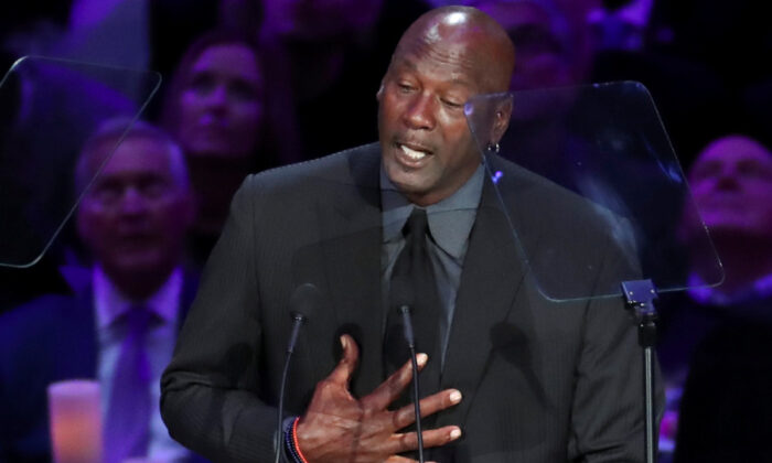 Former basketball player Michael Jordan speaks during a public memorial for NBA great Kobe Bryant, his daughter Gianna and seven others killed in a helicopter crash on Jan. 26, at the Staples Center in Los Angeles, Calif., on Feb. 24, 2020. (Lucy Nicholson/Reuters)