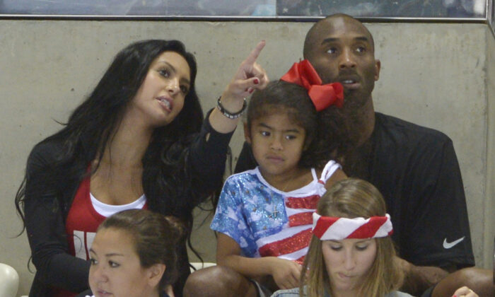 Kobe Bryant with his wife Vanessa and daughter Gianna prepare to watch the final night of swimming at the Aquatics Centre in the Olympic Park during the 2012 Summer Olympics in London on Aug. 4, 2012. (Mark J. Terrill/AP Photo/File)