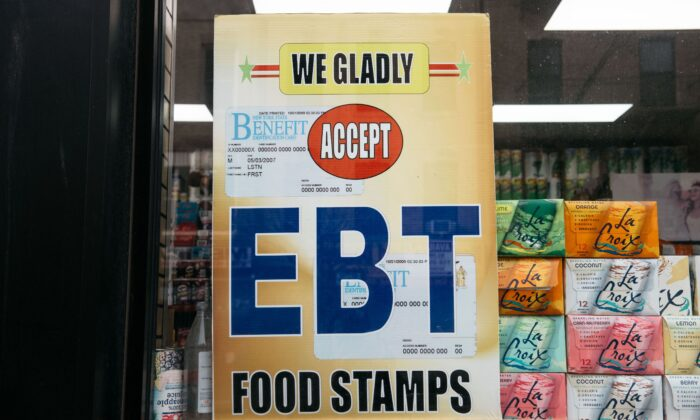 A sign alerting customers about SNAP food stamps benefits is displayed at a grocery store in New York on Dec. 5, 2019. (Scott Heins/Getty Images)