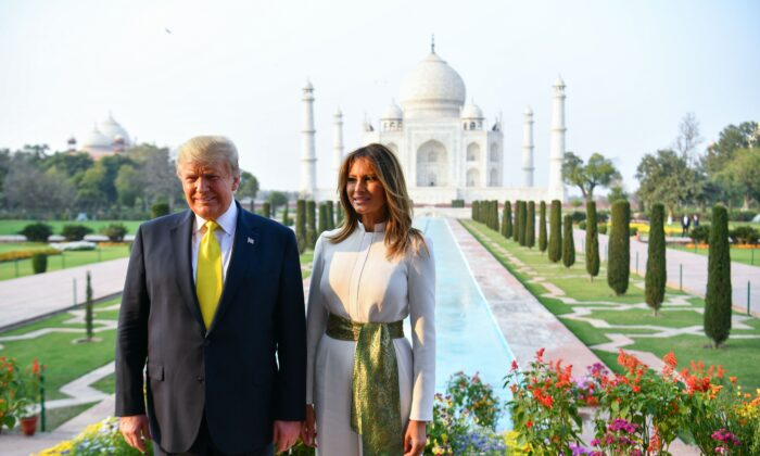 U.S. President Donald Trump and First Lady Melania Trump pose as they visit the Taj Mahal in Agra, India, on Feb. 24, 2020. (Mandel Ngan/AFP via Getty Images)