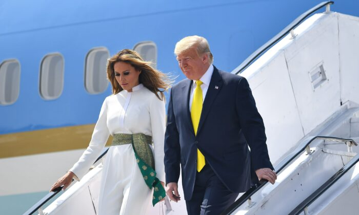 U.S. President Donald Trump and First Lady Melania Trump disembark from Air Force One at Sardar Vallabhbhai Patel International Airport in Ahmedabad, India, on Feb. 24, 2020. (Mandel Ngan/AFP via Getty Images)