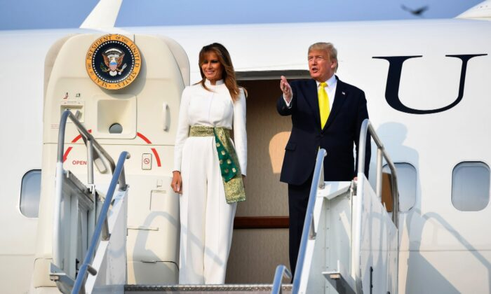 U.S. President Donald Trump and First Lady Melania Trump disembark from Air Force One upon their arrival at Agra Air Base in Agra, India, on Feb. 24, 2020. (Mandel Ngan/AFP/Getty Images)