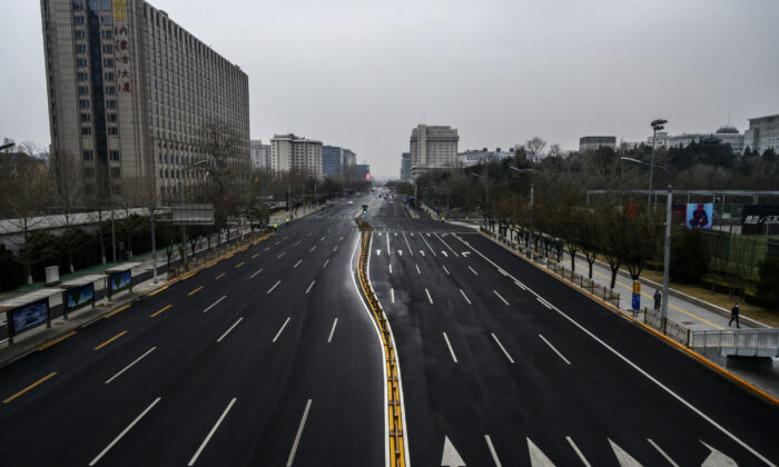 A road is seen much less busy than usual in Beijing, China, on Feb. 24, 2020. (Kevin Frayer/Getty Images)