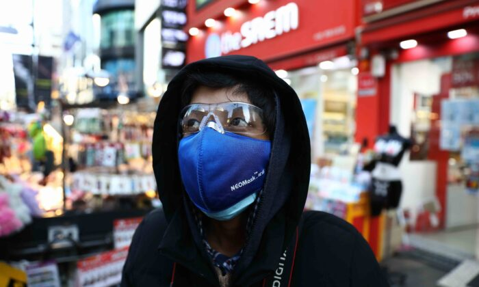 A man wearing a mask to prevent the coronavirus walks in the Myungdong shopping district in Seoul on Feb. 23, 2020. (Chung Sung-Jun/Getty Images)