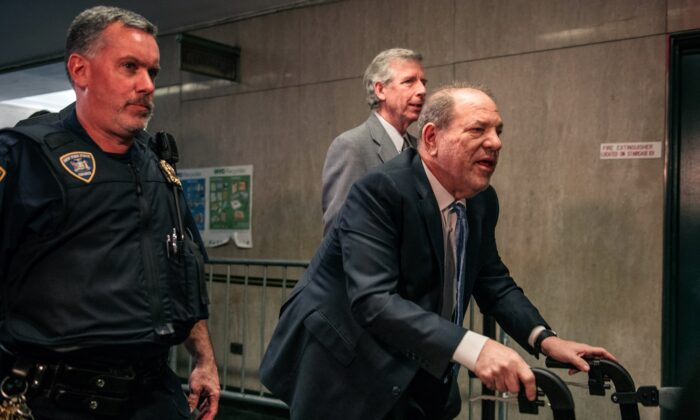 Movie producer Harvey Weinstein (R) enters New York City Criminal Court on Feb. 24, 2020. (Scott Heins/Getty Images)