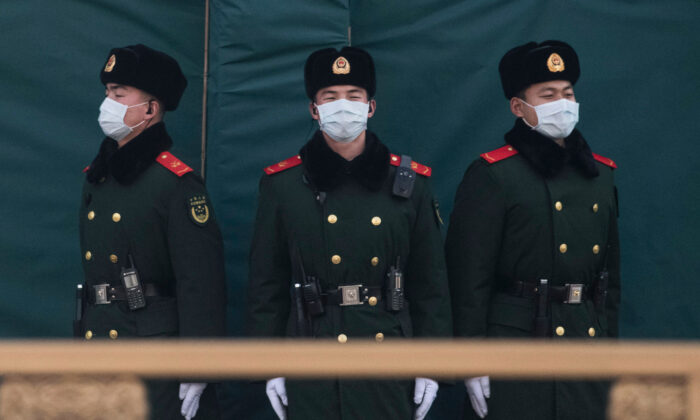 Chinese police wear protective masks as they stand guard on a main road in Beijing, China, on Jan. 31, 2020. (Kevin Frayer/Getty Images)