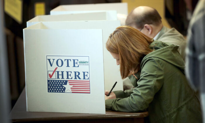 Voters cast ballots at a polling place in Kirkwood, Mo., on Nov. 6, 2018. (Scott Olson/Getty Images)