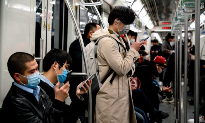 Passengers wearing protective face masks travel on the subway in Shanghai on Feb. 25, 2020. (Noel Celis/AFP via Getty Images)