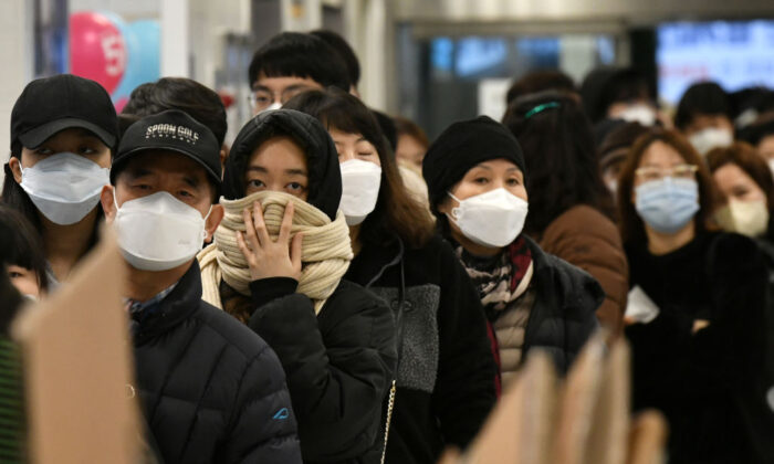 People wait in line to buy face masks at a retail store in Daegu, South Korea, on Feb. 25, 2020. (Jung Yeon-je/AFP via Getty Images)