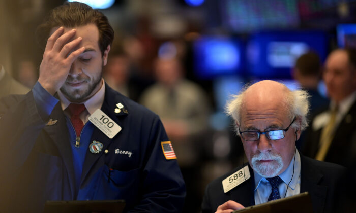 Traders work during the closing bell at the New York Stock Exchange (NYSE) at Wall Street in New York City on Feb. 24, 2020. (Johannes Eisele/AFP via Getty Images)