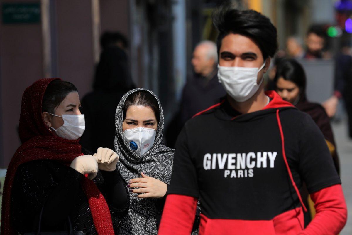 Pedestrians wear masks to help guard against the Coronavirus