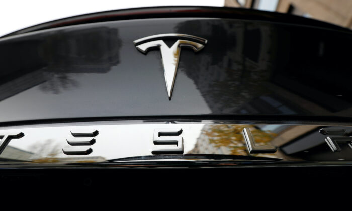 The company logo is pictured on a Tesla Model X electric car in Berlin, Germany on Nov. 13, 2019.    (Fabrizio Bensch/Reuters)